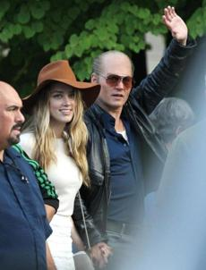 Johnny Depp got a visit from his fiance Amber Heard while filming the adaptation of