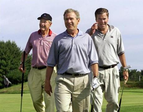 President Bush, right, walks off the 18th hole with his brother Fla. Gov. Jeb Bush, center, and father, former President George Bush, far left, at the Cape Arundel Golf Club in Kennebunkport, Maine, Saturday, July 7, 2001. The Bush family is vacationing at Walker's Point, the family estate in Kennebunkport. (AP Photo/J. Scott Applewhite) Library Tag 07082001 NATIONAL Library Tag 01182004 Magazine Library Tag 01172005 National