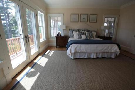 The first-floor master suite has French doors leading to the rear deck, a walk-in closet so large it has its own window, and a full, showered bath with heated floor.
