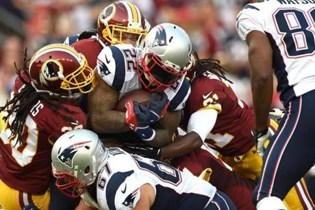 Stevan Ridley was tackled in the first quarter. The Redskins took a strong lead over New England in the first half.