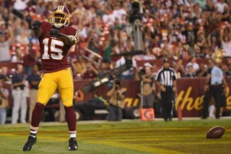 Aldrick Robinson celebrated his first-quarter touchdown against the Patriots.