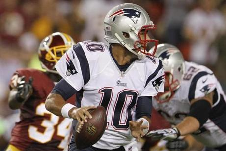 Jimmy Garoppolo, pictured in second-half action, threw a touchdown pass late in the game.