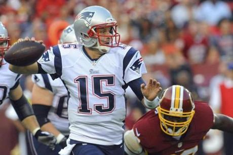 Ryan Mallett prepared to throw as defensive end Jarvis Jenkins closed in on the Patriot.
