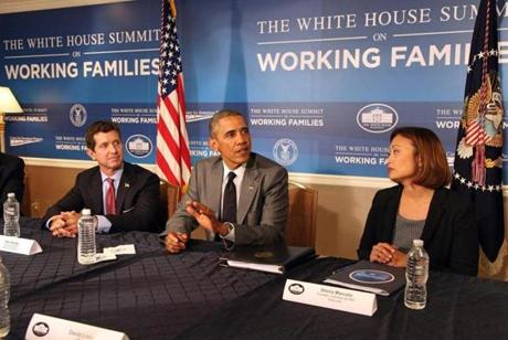 epa04275599 US President Barack Obama meets with Alex Gorsky (L) CEO, Johnson & Johnson, and Sheila Marcello (R), CEO, CARE.com at the first White House Summit on Working Families, in Washington DC, USA, 23 June 2014. The first-ever White House Summit on Working Families was held to discuss flexible workplace policies beneficial to working parents and employers. EPA/MARTIN H SIMON / POOL