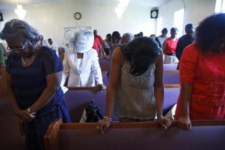 Worshipers at a recent service of the West Camp Missionary Baptist Church in Batesville, Miss. The church, which has been renovated and expanded since 1964, was the first place that local Freedom Summer volunteers met members of the black community, on the Sunday they arrived. It also housed mass meetings in the evenings, with local people coming together to listen to speeches and songs -- in the style of sermons and hymns -- about civil rights and the voting drive.