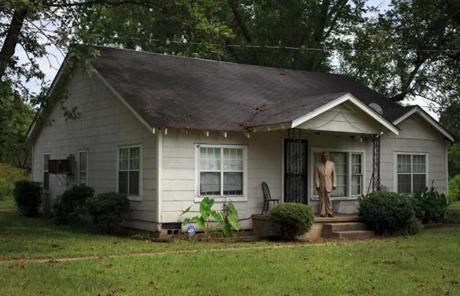 Robert Miles Jr. stood outside of his family home in Batesville, Miss.