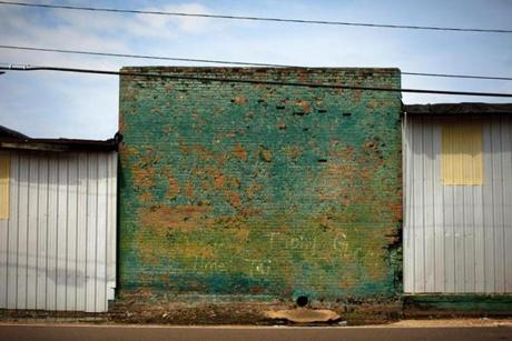 8/9/14 - Greenwood, MS - Decades of repair and neglect show on this wall in Greenwood, MS. Topic: 31freedom. Story by Eric Moskowitz/Globe Staff. Dina Rudick/Globe Staff