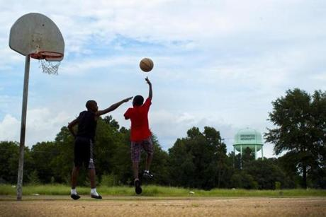 8/9/14 - Greenwood, MS - Jarvis Clay, cq, 12, left, and Jaikee Smith, cq, right, 11, play one-one-one at Broad Street Historical Park in Greenwood, MS on August 9, 2014. The park is the location of the famous