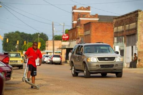 8/9/14 - Greenwood, MS - The setting sun illuminated the avenues of Greenwood, MS on Saturday evening, August 9, 2014. Topic: 31freedom. Story by Eric Moskowitz/Globe Staff. Dina Rudick/Globe Staff