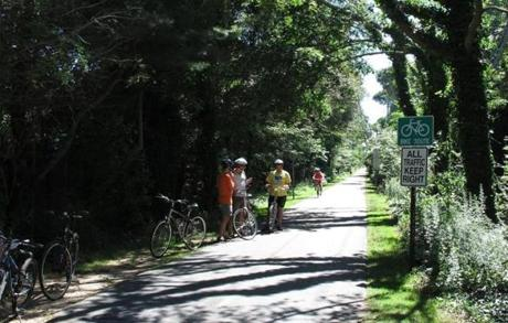 The Shining Sea Bikeway, a paved path that runs past wooded uplands, salt marshes, and barrier beaches.