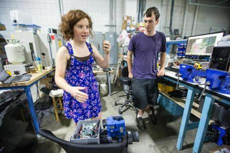 08/22/2014 SOMERVILLE, MA Interns Kari Bender (cq) (left) 20, and David Pudlo (cq) 21, of Loci Controls (cq) demonstrate a well watcher system at Greentown Labs (cq) in Somerville. (Aram Boghosian for The Boston Globe)