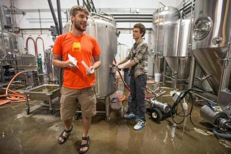08/22/2014 SOMERVILLE, MA Co-founders Ben Holmes (cq) (left) and Dan Rassi (cq) work in the brewery at Aeronaut (cq) in Somerville. (Aram Boghosian for The Boston Globe)