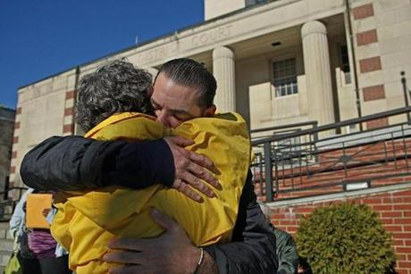 Mike Bourne hugged his aunt, Rhonda, after a court approved his release from Worcester State Hospital.