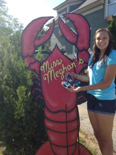 Meghan LaPlante showed off her blue lobster.