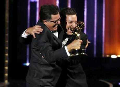 Stephen Colbert, left, and Jimmy Fallon celebrated after Colbert accepted the award for oustanding variety series for