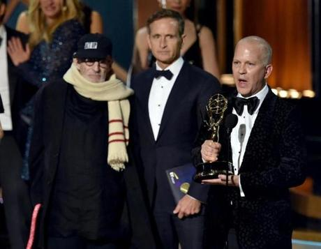 LOS ANGELES, CA - AUGUST 25: Writer Larry Kramer (L) and director/producer Ryan Murphy (R) accept Outstanding Television Movie for 'The Normal Heart' onstage at the 66th Annual Primetime Emmy Awards held at Nokia Theatre L.A. Live on August 25, 2014 in Los Angeles, California. (Photo by Kevin Winter/Getty Images)