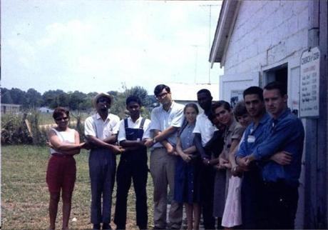 SNCC staff members joined hands.