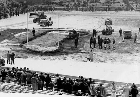 December 20 1964 / fromthearchive / Globe Staff photo by Paul J. Maguire / Players and officials checked the field being cleared of snow before the game at Fenway Park. The game against the Buffalo Bills was delayed 35 minutes. The Bills beat the Patriots 24-14 and denied the 38,021 fans the chance to see the Boston Patriots win the championship of the American Football League's Eastern division.
