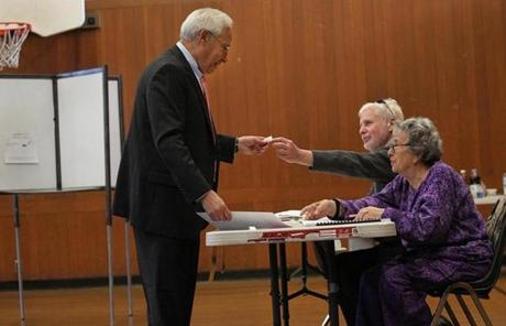 Democrat Don Berwick got a sticker after he voted at Hyde Community Center.