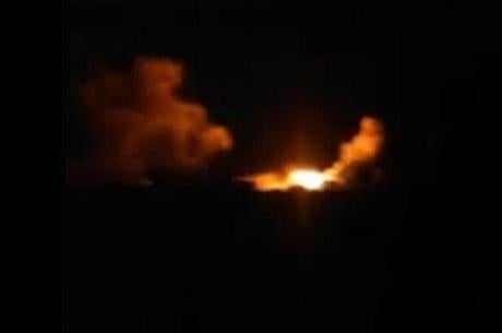 This image made from amateur video posted on an activist social media account early Tuesday, Sept. 23, 2014, which has been verified and is consistent with other AP reporting, shows an explosion in the village of Kfar Derian, Syria. The Syrian foreign ministry said Tuesday that Washington informed Damascus' envoy to the United Nations before launching airstrikes against the Islamic State group in Syria, attacks that activists said inflicted casualties among jihadi fighters on the ground. Rami Abdurrahman, who heads the Britain-based Syrian Observatory for Human Rights, an activist group, said missiles also targeted the village of Kfar Derian, which is a base for the al-Qaida-linked Nusra Front, which is a rival of the Islamic State group. Abdurrahman said those strikes appear to have been carried by the U.S. (AP Photo/amateur video via AP video)