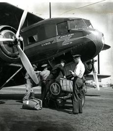 June 28 1936 / fromthearchive / Boston Globe Archive photo / Pilots checked off the United States mail pouches and the passenger luggage as they were stowed away in the baggage compartment under the controls of the American Airlines Condor 159 plane.