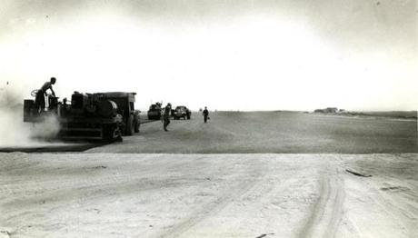 July 7 1946 / fromthearchive / Boston Globe Archive photo / The making of runway A and runway B involved trucking in about 1,100,000 cubic yards of yellowish gray gravel for fill for the new 7000 foot runways. Nearly 300 trucks a day piled high with the gravel made the trip from gravel pits in Middleton and Peabody.