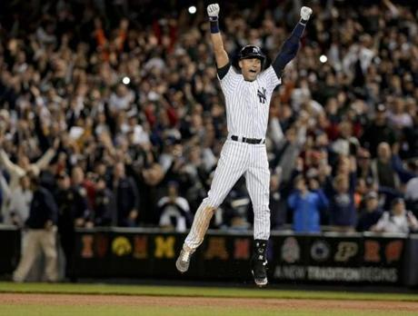 Jeter celebrated when the winning run crossed the plate. (AP Photo/Julie Jacobson)