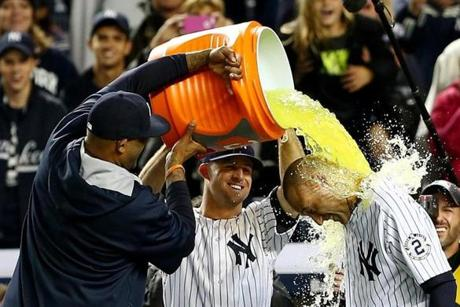 CC Sabathia and Brett Gardner dumped Gatorade on Jeter during the postgame celebration. (Photo by Elsa/Getty Images)