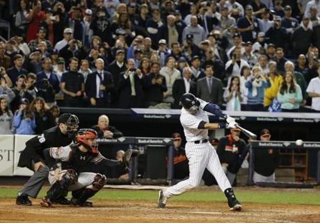 Derek Jeter capped his Yankee Stadium farewell with a game-winning, walk-off single in the bottom of the ninth inning. Jeter lined the first pitch he saw through a wide hole on the right side, and pinch-runner Antoan Richardson slid home ahead of Nick Markakis' throw. The Yankees won 6-5.  (AP Photo/Kathy Willens)