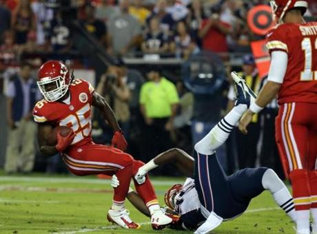 Jamaal Charles carries the ball in the first quarter. (Barry Chin/Globe Staff)