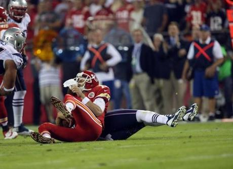Kansas City quarterback Alex  Smith was sacked by Chandler Jones in the first quarter. (Barry Chin/Globe Staff)