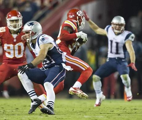 Kansas City safety Husain Abdullah jumped Danny Amendola's route to intercept Tom Brady for a pick six during the fourth quarter. (Matthew J. Lee/Globe staff)