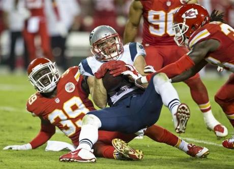 New England Patriots receiver Julian Edelman was tackled by Kansas City Chiefs Husain Abdullah (39) and Ron Parker during the fourth quarter. (Matthew J. Lee/Globe staff)
