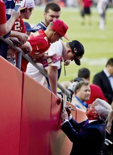 New England Patriots owner Robert Kraft signed his autograph for fans before the game. (Matthew J. Lee/Globe staff)