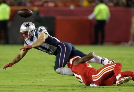 Kansas City Chiefs cornerback Marcus Cooper broke up a pass intended for Patriots wide receiver Julian Edelman. (Barry Chin/Globe Staff)