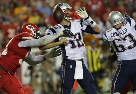 With the score 17-0 in the third quarter, Kansas City Chiefs outside linebacker Tamba Hali stripped the ball from  Tom Brady. (Barry Chin/Globe Staff)