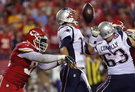 The Chiefs recovered the fumble at the New England nine yard line and went on to score two plays later to go up 24-0.  (Barry Chin/Globe Staff)