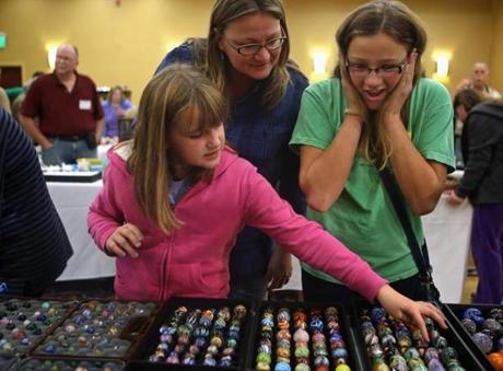 Marlborough, MA 10/12/14 Carly Andrulat, 12, right, South Windsor, CT, has been a collector