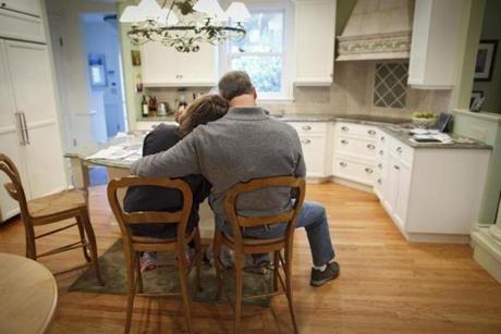 7:58 am - 10/26/14 - Swampscott, MA - PHOTO ESSAY - Lauren Baker, cq, rester her head on her husband Charlie Baker's shoulder during breakfast while they looked over a newspaper article that they felt was unfair to Charlie. Charlie Baker and his wife, Lauren Baker, had coffee and breakfast before Charlie left for a long day of campaigning on October 26, 2014. One day on the campaign trail with Republican candidate for Massachusetts Governor, Charlie Baker. Item: photo essays. Dina Rudick/Globe Staff.
