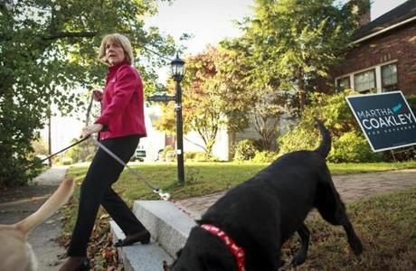 8:16 am - 10/25/14 - Medford, MA - PHOTO ESSAY - State Attorney General and Democratic candidate for Governor Martha Coakley took her dogs for a quick walk before leaving her home early Saturday morning, October 25, 2014.for a full day of campaigning. One day on the campaign trail with Democratic candidate for Massachusetts Governor, State Attorney General Martha Coakley. Item: photo essays. Dina Rudick/Globe Staff.
