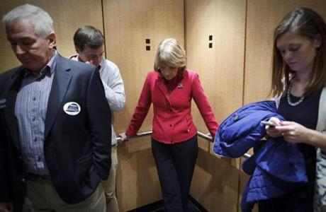 10:49 am - 10/25/14 - Boston, MA - PHOTO ESSAY - Westin Hotel - State Attorney General and Democratic candidate for Governor Martha Coakley rode the elevator down after appearing at the Massachusetts Association of Community Development Corporations Gubernatorial Forum at the Westing Hotel on Saturday October 25, 2014. One day on the campaign trail with Democratic candidate for Massachusetts Governor, State Attorney General Martha Coakley. Item: photo essays. Dina Rudick/Globe Staff.