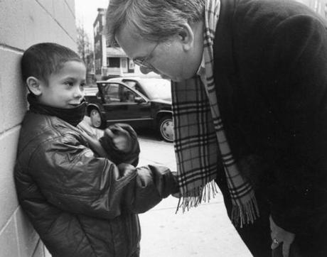 As he did for many years, Menino visited the Geneva Avenue neighborhood on Christmas Eve 1993, offering help to local businesses,  and asking kids like Jonathan Pagan, 8, how they were doing in school.