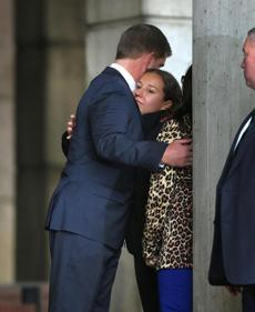 Walsh embraced a woman on the steps of City Hall.