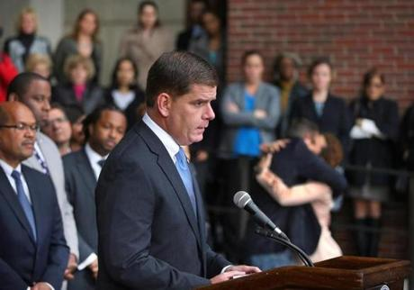 Mayor Martin J. Walsh spoke about Menino outside City Hall .