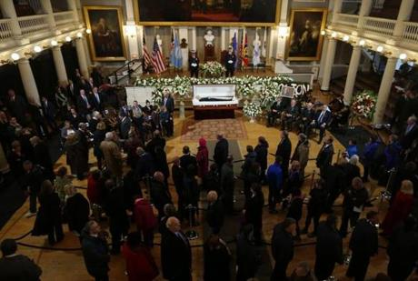 People arrive to pay their respects as former Mayor Thomas Menino lies in state inside Faneuil Hall in Boston, Massachusetts November 2, 2014.