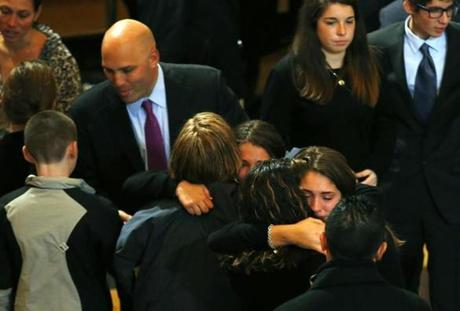 Menino's granddaughters, Taylor and Samantha Menino, embraced.