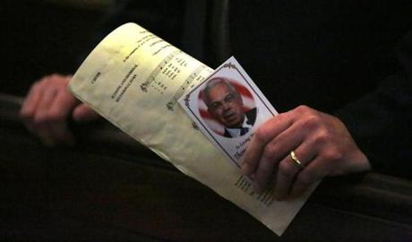 Tom Lyons, who formerly worked for the city with the Boston Public Health Commission  and EMS, clutches a program and a prayer card. A memorial Mass for former Mayor Thomas M. Menino was held at the Cathedral of the Holy Cross.
