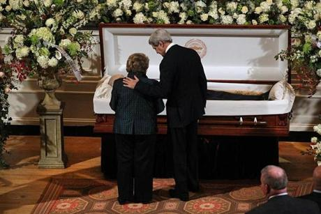 John Kerry and Angela Menino stood at Thomas Menino's casket.