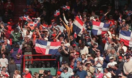 Fans waving the flag of the Dominican Republic for Pedro Martinez became commonplace at Fenway Park.