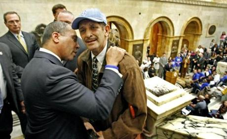 Governor Patrick spoke with a distraught man at an antiviolence rally in 2008.